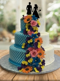 Wedding Cake three tier with cascading handmade flowers by Goodies Bakeshop