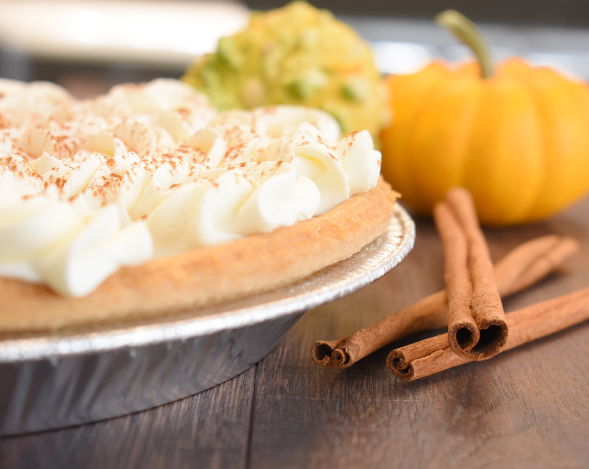 Goodies Bakeshop Classic Pumpkin Pie on a hand made flaky crust filled with our classic pumpkin recipe using real pumpkin and topped with real whip cream and a dash of cinnamon, our Fall Favorite!